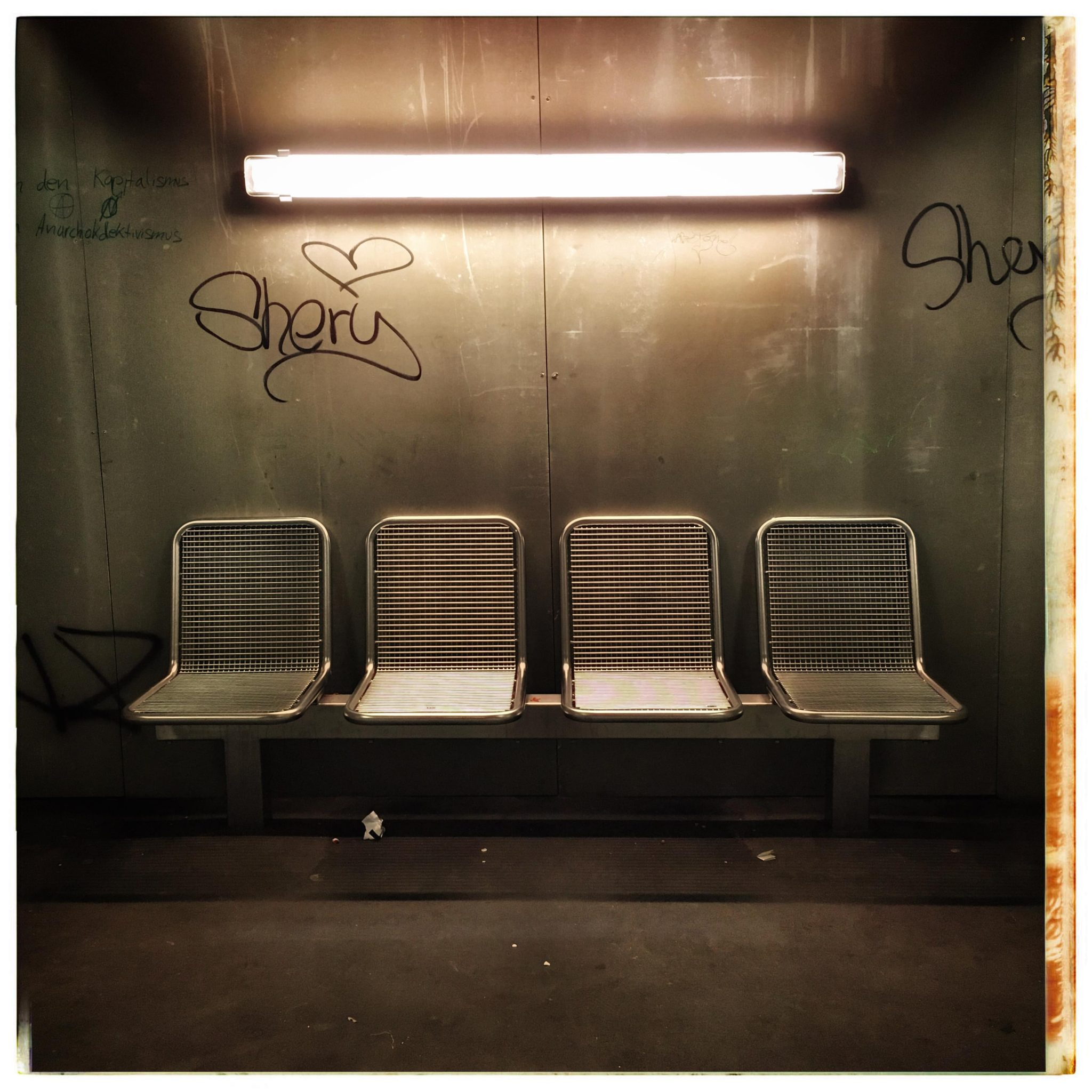 4 waiting chairs at an underground station